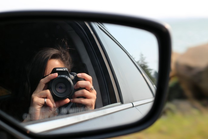 sideview mirror reflection photo on roadtrip