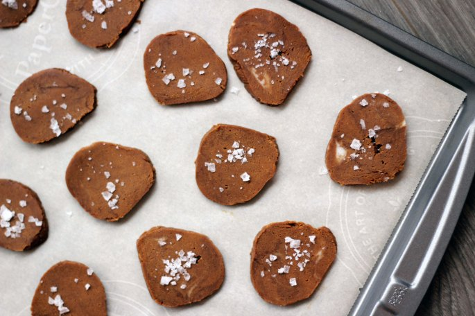 unbaked gingersnaps on a cookie sheet