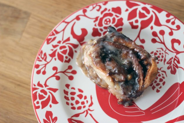 cinnamon bun with icing on plate