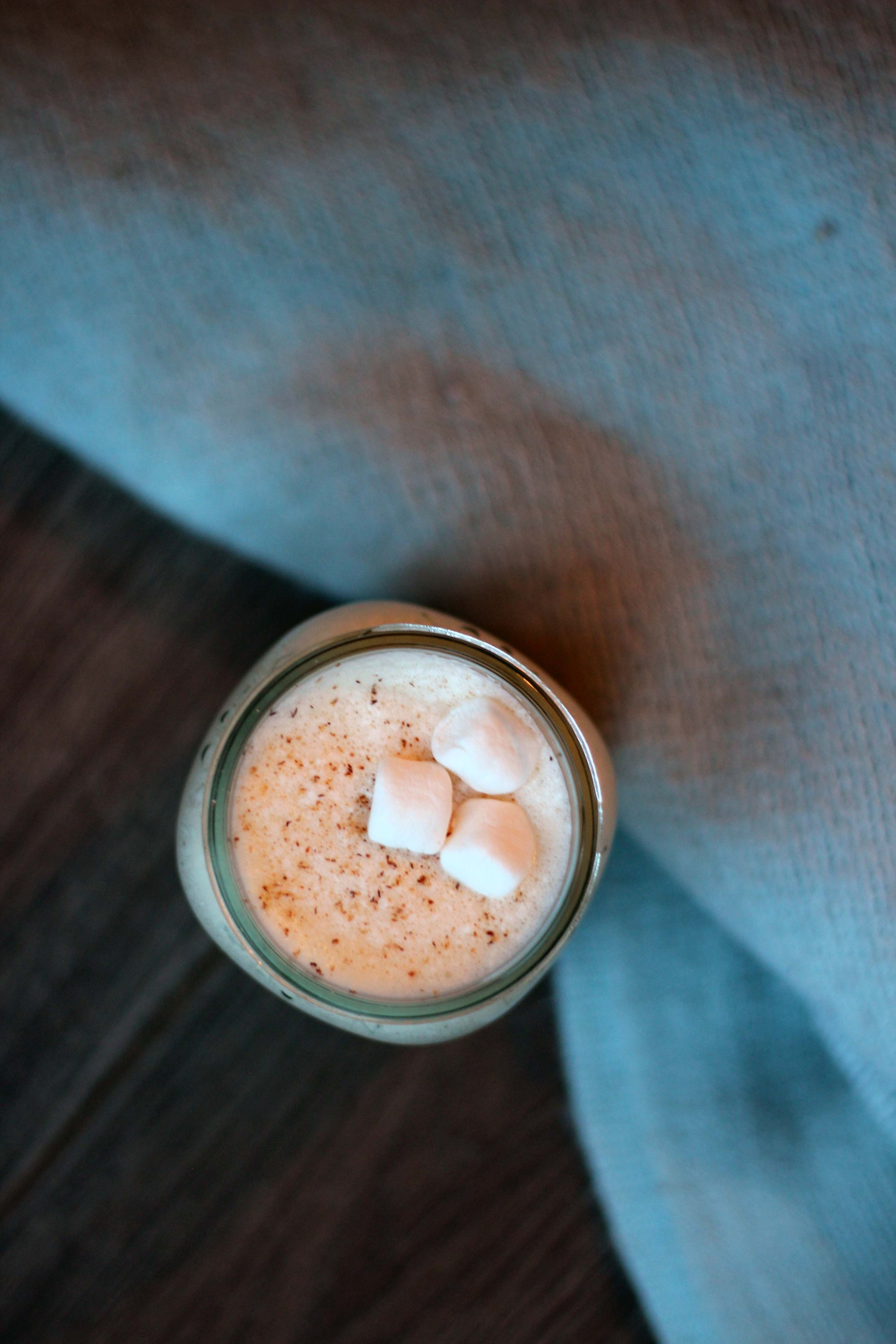 homemade cooked eggnog with spiced whiskey