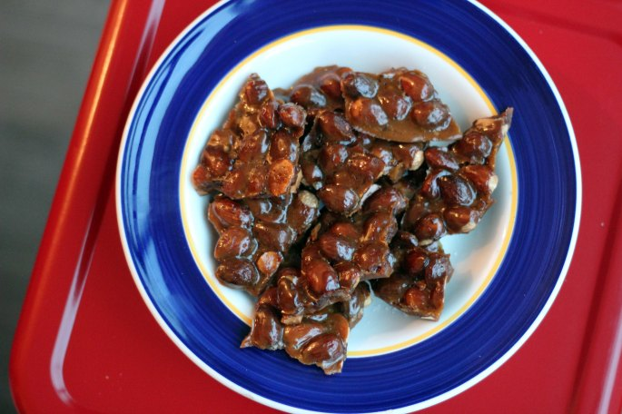almond brittle in blue bowl