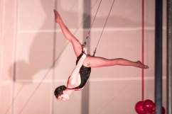 flying trapeze artist doing splits