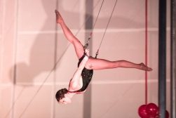 flying trapeze artist doing splits