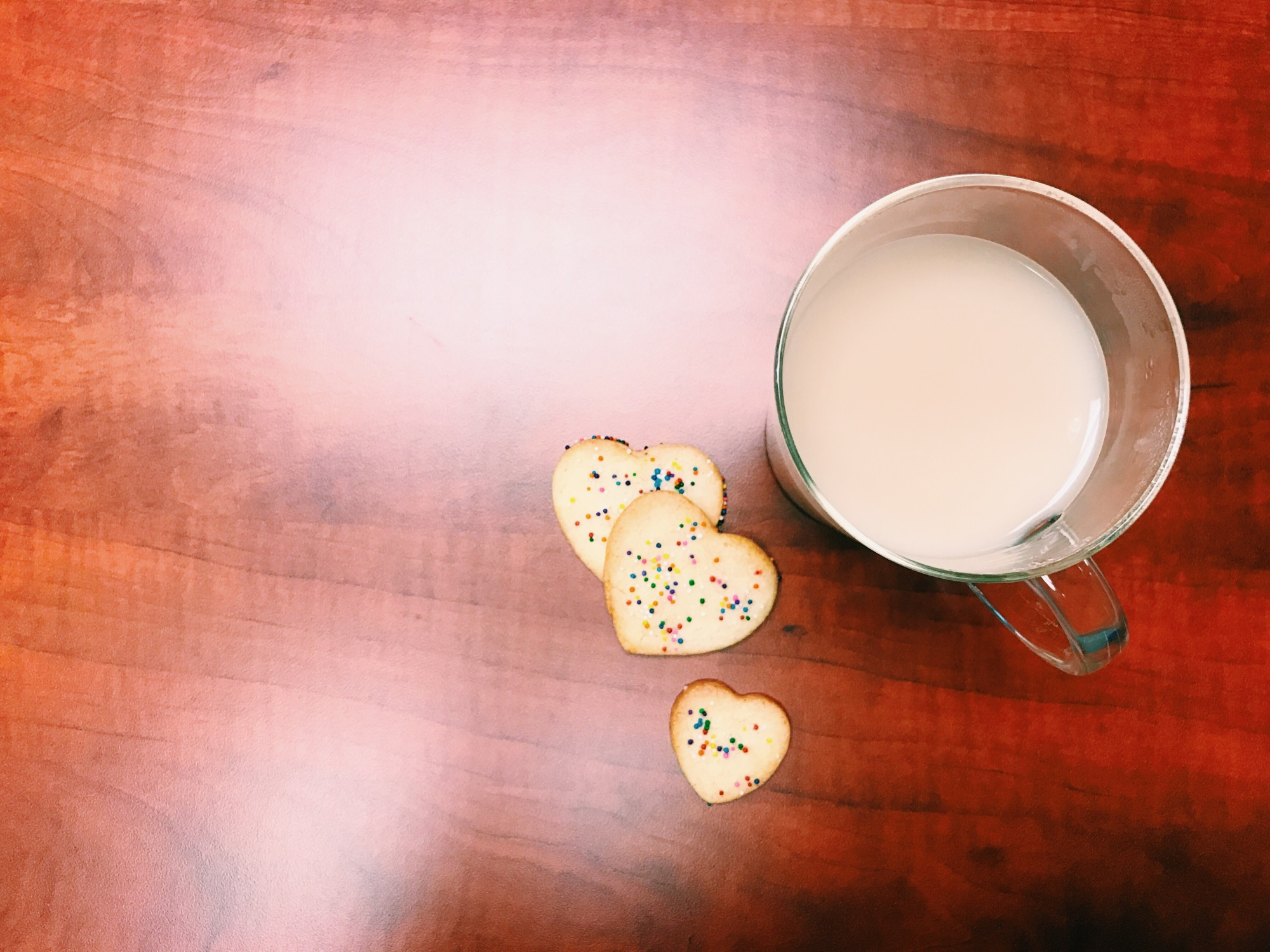 sugar cookies with sprinkles and tea