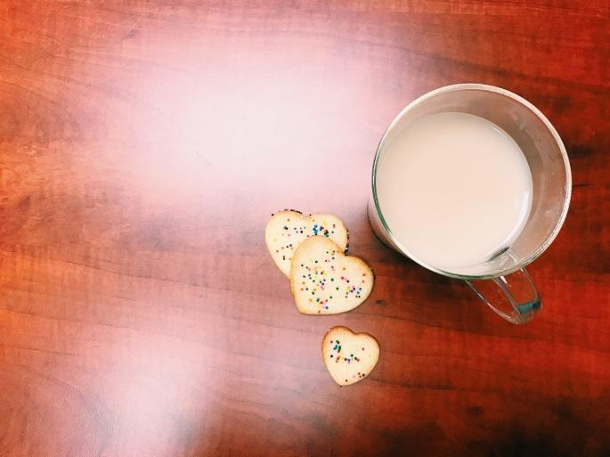 sugar cookies with sprinkles and tea