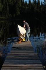 launching the canoe into the lake
