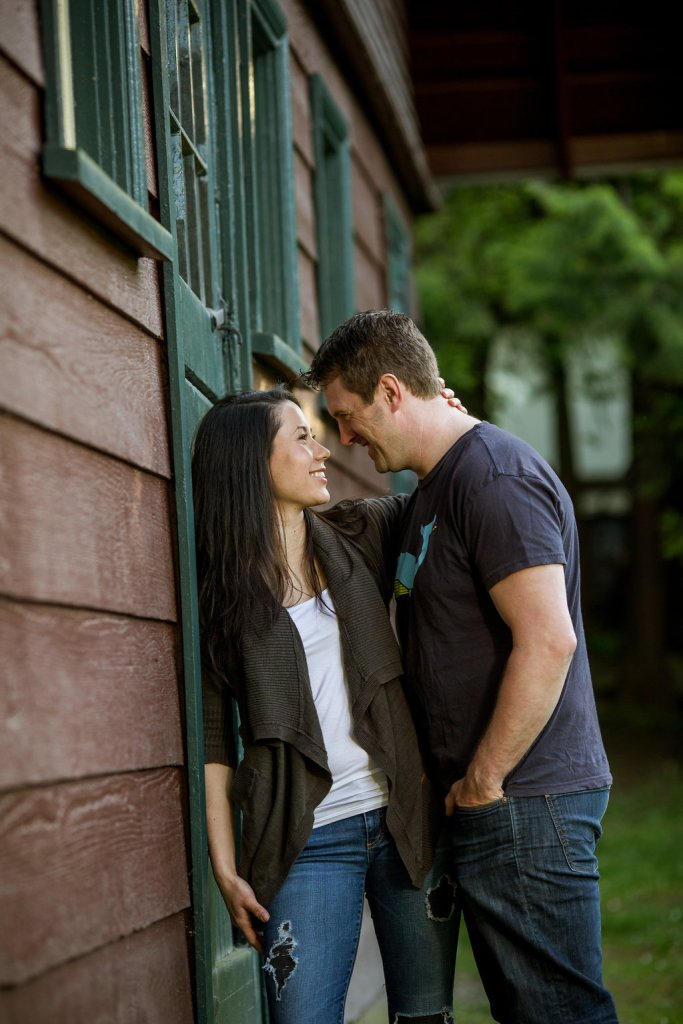 engaged couple outside house at deer lake park