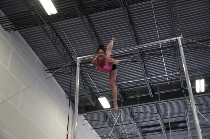 girl doing splits on flying trapeze no safety lines