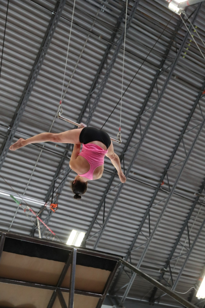 back end straddle whip on flying trapeze