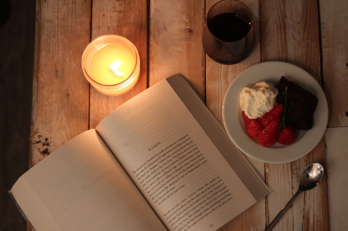 dessert wine candle and a book
